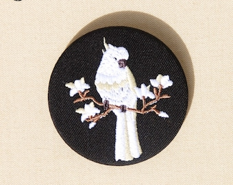 Brooch embroidered cockatoo on branch of magnolia