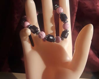 PRICED REDUCED! Pink and black with silver spacers/handcrafted/stretch cord