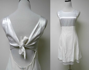 T.W.H. 90s  cut-out / tie back . little white dress . size 7 / 8 . made in USA