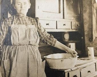 Granny in Kitchen Vintage Photo Hoosier Cabinet, Enamel Bowl, Gingham Apron