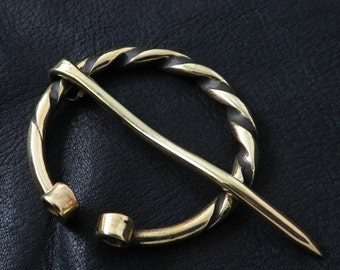 Massive brass penannular Viking brooch