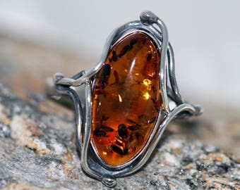 Large Cognac Baltic Amber Ring fitted in Sterling Silver setting. Wiccan jewelry, celtic jewelry. Cognac Amber silver statement ring.