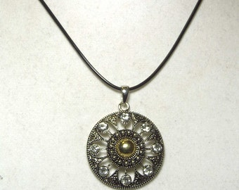"Cynthia Lynn ""TENACIOUS"" Silver Gold Plated Crystal Medallion Black Cord Necklace 16-18"""