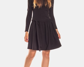 Black dress with asymetric zip and bow