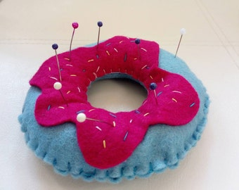 Pin cushion. Blueberry donut with raspberry jam