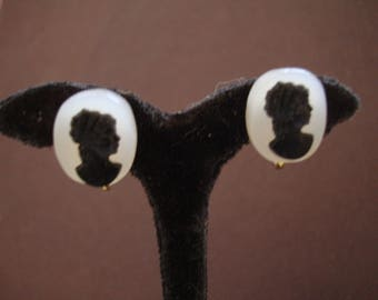 CAMEO EARS are 5/8 inch tall by 1/2 inch wide ovals made of black and white PLASTIC. Please see photos and description area for more info.