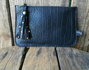 Large pocket in black leather and rivets