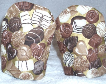 Pair of luxury chocolates on gold Egg Cosies