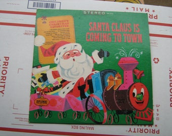 Santa claus is coming to town Damon King the Caroleer singers and orchestra on Diplomat records  # SX-1710