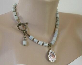 Antiqued Brass Swarovski Teardrop Pendant and Aquamarine Barrel Necklace Side Closure