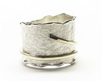 Ring with a gold stripe