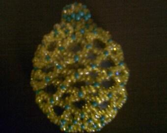 Beaded russian egg pendant.