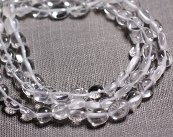 Wire 39cm 44pc env - stone beads - clear Quartz Nuggets 7-10mm Olive