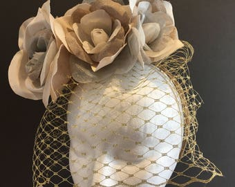 Bridal headpiece with gold birdcage veil and roses