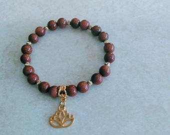 Gold Sandstone Beads with Gold Spacers and Lotus Charm Bracelet