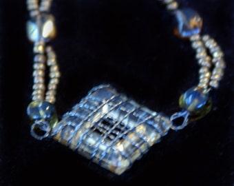 original art pendant  Caged Amber beaded