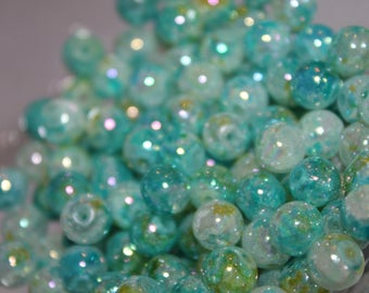 50 x glass beads in shades of green.