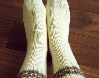 100% Undyed Wool socks for men and women. They are size 7-9. Simple, cozy and warm. Natural cream color with a grey detail.
