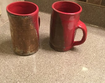 Red and light gold coffee cups