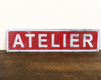 Painted tin workshop sign