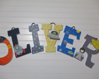 "OLIVER - 12.00 PER LETTER boy's name, 8-1/2"" to 9"" wood letters, space nursery name, space theme, space ships, stars, astronaut, outer space"