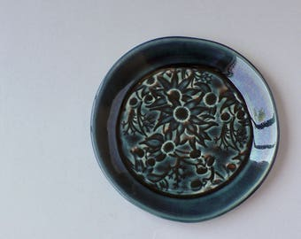 Deep blue ceramic plate with Australian Flannel Flowers