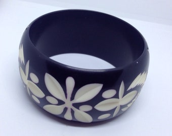 Carved over painted resin bangle