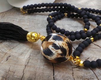 Long beaded black tassel necklace. Animal print necklace.  Boho necklace.  Long black beaded  tassel necklace with animal print bead.