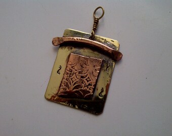 Copper and Brass pendant with etched face