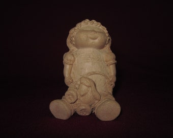 "Little girl w/ rabbit pull toy, 3"" molded pecan resin figurine,unpainted"