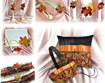 Fall leaves ring pillow, basket, bridal garters, guest book, unity candle set, cake knife set and champagne glasses