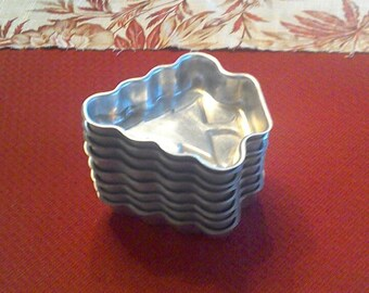 Vintage Aluminum Christmas Jello Molds. Just in time for the Holidays.