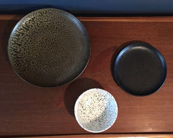 Set of Three Speckled Pottery Plates and a Bowl Italian