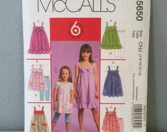 McCalls Sewing Pattern M5650 Children's Girls Dress Jumper Top and Leggings Size CHJ 7 8 10 12 14