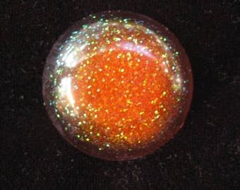Large cabochon with orange glitter resin ring