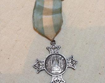 Lourdes medal on a ribbon