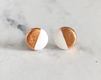 white and copper clay studs