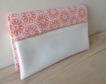 Coral and white imitation leather checkbook covers.