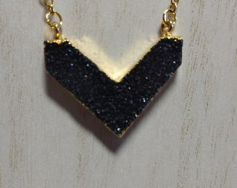 Black V-shaped druzy pendant on gold plated chain