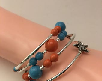 Fun Swarovski Crystal coral and turquoise memory wire bracelet set with silver plated assorted starfish.