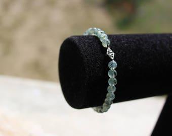 prehnite bracelet develops zest for life, vitality, optimism and communication.