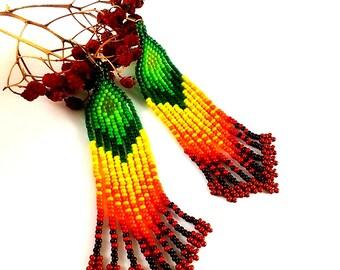 Statement Jewelry Beaded earrings with fringe Carmine earrings Dangle earrings Orange earrings Green jewelry Clover earrings Beadwoven