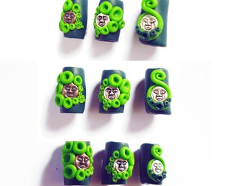 Green swirly face goddess dreadlock bead.