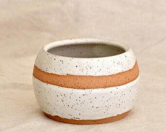 Wheel thrown speckled stoneware planter with white glaze