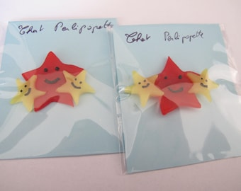 Red and yellow star trio brooch