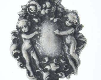 Brass stamping Cherubs  , victorian motif ,  sold by each 04226AS
