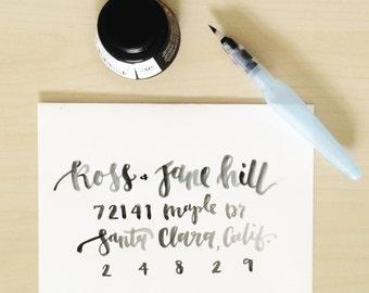 envelope addressing | black water brush lettering on white