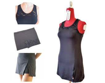 Elegant black tennis dress, camisole neckline with quilted triangles on tulle and hand carved, matching shorts