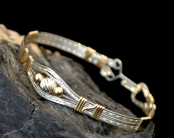 "Sterling silver and 14K gold filled wire wrapped bracelet.   ""Ru la la"""