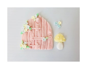 Edible fairy door. Pink wood affect with flower detail and toadstool.